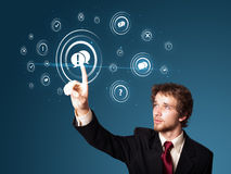 Businessman pressing modern social type of icons Stock Photo