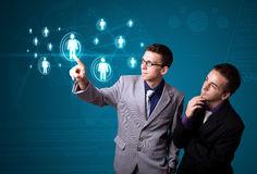Businessman pressing modern social type of icons Royalty Free Stock Photos