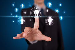 Businessman pressing modern social type of icons Royalty Free Stock Images