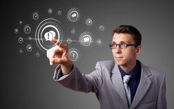 Businessman pressing modern social type of icons Royalty Free Stock Photo