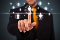 Businessman pressing modern social type of icons Stock Photos