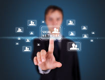 Businessman pressing modern social type of icons Royalty Free Stock Photography