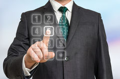 Businessman pressing numerical button on virtual touch screen Stock Images
