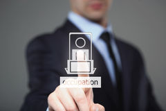 Businessman pressing occupation button on virtual screens. Royalty Free Stock Photos