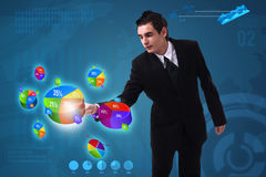 Businessman pressing pie chart button Stock Photos