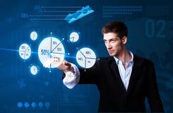 Businessman pressing pie chart button Royalty Free Stock Photos