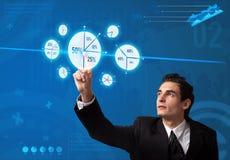 Businessman pressing pie chart button Stock Image