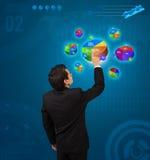 Businessman pressing pie chart button Stock Photos