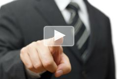 Businessman pressing play button to start.  royalty free stock images