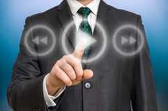 Businessman pressing play button on a virtual background Stock Photography