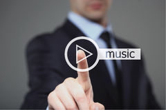 Businessman pressing play music button Stock Photography