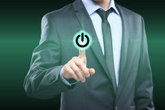 Businessman pressing power button concept Royalty Free Stock Photography