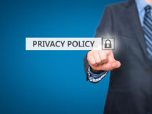 Businessman pressing Privacy Policy button on virtual screens Royalty Free Stock Image