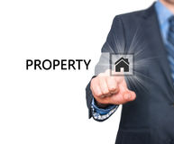 Businessman pressing property button on virtual screens Royalty Free Stock Image