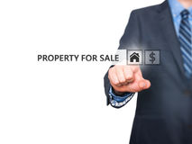 Businessman pressing property for sale button on virtual screen Stock Photos