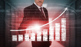 Businessman pressing red chart and arrow interface Royalty Free Stock Images