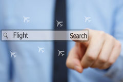 Businessman is pressing search button for finding cheap flights royalty free stock photo