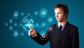 Businessman pressing simple type of start buttons Stock Image