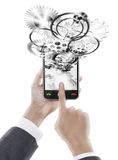 Businessman pressing smart phone with gear wheel Stock Photos