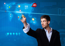 Businessman pressing social media button on digital map stock photos