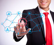 Businessman pressing social network buttons Royalty Free Stock Photo