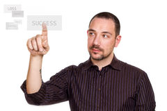 Businessman pressing the success button Royalty Free Stock Images