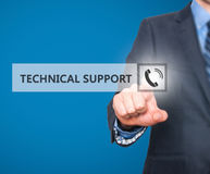 Businessman pressing technical support button on virtual screens Stock Image