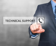 Businessman pressing technical support button on virtual screens Royalty Free Stock Photography