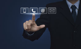 Businessman pressing telephone, mobile phone, at and email butto. Ns over blue background, Customer support concept Stock Photo