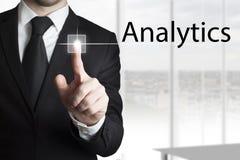 Businessman pressing touchscreen analytics Stock Photo