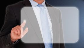 Businessman pressing touchscreen Stock Photo