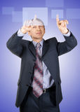 Businessman pressing a touchscreen button Stock Photography