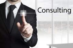 Businessman pressing touchscreen button consulting. Businessman in black suit pressing touchscreen button consulting Stock Photos