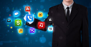 Businessman pressing various collection of buttons Royalty Free Stock Images