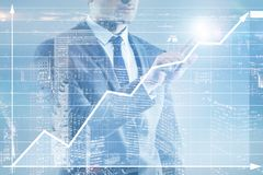 The businessman pressing virtual button on diagram chart Royalty Free Stock Photos