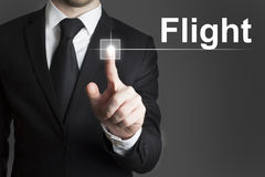 Businessman pressing virtual button flight Stock Photography