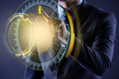 The businessman pressing virtual button in futuristic concept. Businessman pressing virtual button in futuristic concept Stock Photography