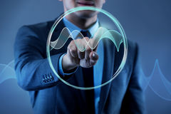 The businessman pressing virtual button in futuristic concept. Businessman pressing virtual button in futuristic concept Royalty Free Stock Images