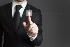 Businessman pressing virtual button stock photo