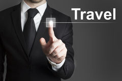 Businessman pressing virtual button travel Stock Image