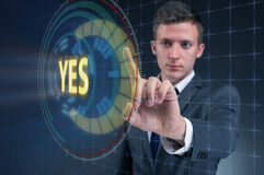 The businessman pressing virtual button yes. Businessman pressing virtual button YES Stock Image
