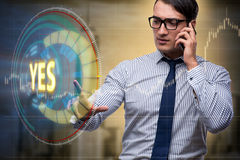 The businessman pressing virtual button yes. Businessman pressing virtual button YES Stock Photo