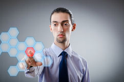 Businessman pressing virtual buttons Stock Image