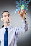 Businessman pressing virtual buttons Stock Photo