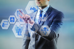 The businessman pressing virtual buttons in business concept. Businessman pressing virtual buttons in business concept Royalty Free Stock Photography