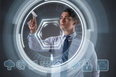 The businessman pressing virtual buttons in business concept. Businessman pressing virtual buttons in business concept Stock Image