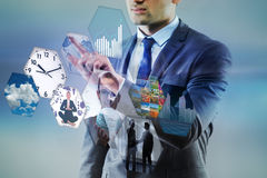 The businessman pressing virtual buttons in business concept. Businessman pressing virtual buttons in business concept Stock Photos