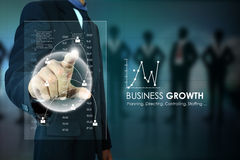 Businessman pressing virtual buttons Stock Photos