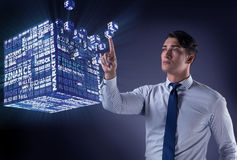 The businessman pressing virtual buttons in concept Stock Photos