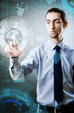 The businessman pressing virtual buttons in futuristic concept Royalty Free Stock Photo